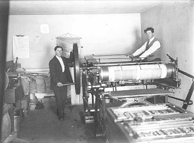 """The Tomahawk"" Press Room, Theodore Hudon Beaulieu, editor, is on the left. Augustus Hudon Beaulieu, publisher, is on the right. Augustus Beaulieu founded ""The Progress"" (White Earth's first weekly newspaper) in 1886. It later became ""The Tomahawk."" The Indian Agent at White Earth initially confiscated the printing press of ""The Progress,"" accusing Augustus Beaulieu of having the intention of ""breaking down the influence of the United States Indian Agent with the Indians."" This censure was overturned in US Federal Court. Printing resumed in 1887. (Information courtesy of Gerald Vizenor, quote from ""Blue Ravens"")"