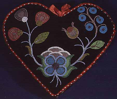 Heart shaped cloth and bead pincushion. Courtesy of Minnesota Historical Society.
